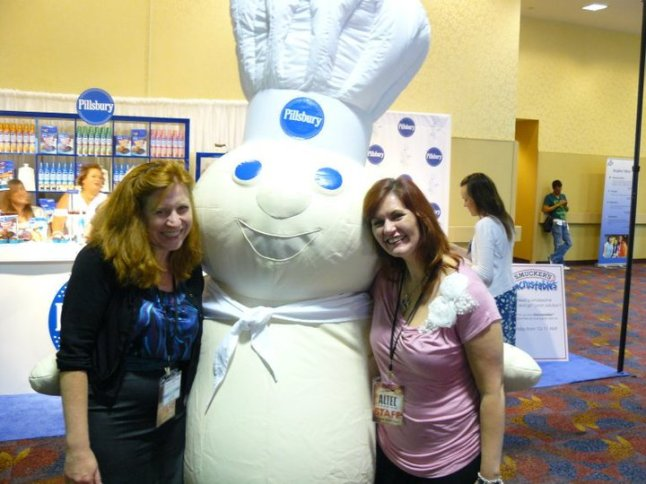 Angel and I sharing a delicious moment with the Pillsbury doughboy at BlogHer '10.